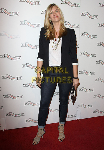 NATASHA HENSTRIDGE .Odd Molly Flagship Store Opening held At Odd Molly Boutique, Beverly Hills, California, USA, 19th March 2010..full length navy blue blazer jacket jeans ankle boots open toe beige suede sandals studs studded white top gold necklace belt skinny denim cage cut out metal clutch bag .CAP/ADM/KB.©Kevan Brooks/AdMedia/Capital Pictures.