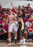 Stanford's Joslyn Tinkle, is being guarded by a Long Beach State players during Saturday, November 25, 2012 game at Stanford. Stanford won 77-41.