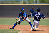 Texas Rangers shortstop Chris Seise (59) prepares to tag Angel Solarte (70) on a stolen base attempt during an Instructional League game against the San Diego Padres on September 20, 2017 at Peoria Sports Complex in Peoria, Arizona. (Zachary Lucy/Four Seam Images)