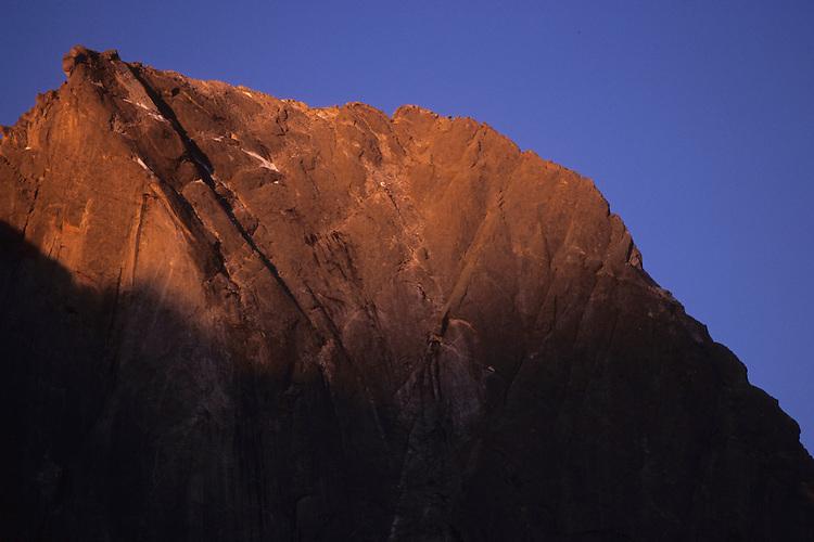 World famous Pizzo Badile granite peak awakes in the sun, Bergell, Switzerland, August 2011.