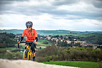 Cyclist riding gravel on the famous Strade Bianche out of Pienza, in Tuscany, Italy