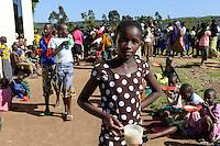 TANZANIA Mara, Tarime, village Masanga, region of the Kuria tribe who practise FGM Female Genital Mutilation, temporary rescue camp of the Diocese Musoma for girls which escaped from their villages to prevent FGM / TANSANIA Mara, Tarime, Dorf Masanga, in der Region lebt der Kuria Tribe, der FGM weibliche Genitalbeschneidung praktiziert, temporaerer Zufluchtsort fuer Maedchen, denen in ihrem Dorf Genitalverstuemmelung droht, in einer Schule der Dioezese Musoma, Verteilung von Nahrungsmittel