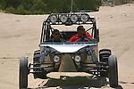 TWO MEXICAN MEN ENJOY OFF ROADING ON SAND DUNES IN SAN FELIPE