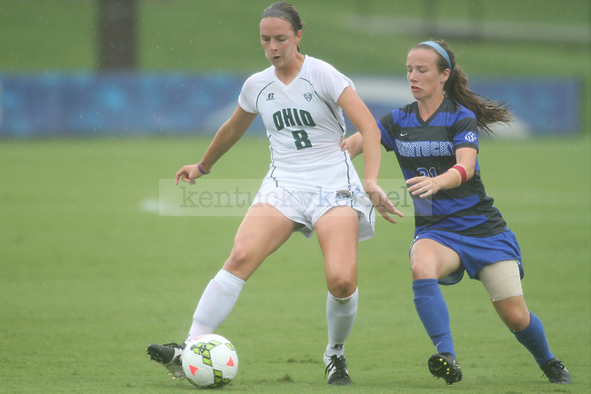 Kentucky senior Stuart Pope fights an Ohio player for the ball during the University of Kentucky vs. Ohio women's soccer game at the Wendell and Vickie Bell Soccer Complex in Lexington, Ky., on Sunday, August 31, 2014. Photo by Jonathan Krueger | Staff