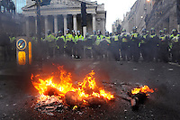 An effigy of a banker burns in front of a police line, blocking the road in front of the Royal Exchange. Thousands of protestors descended on the City of London ahead of the G20 summit of world leaders to express anger at the economic crisis, which many blame on the excesses of capitalism.