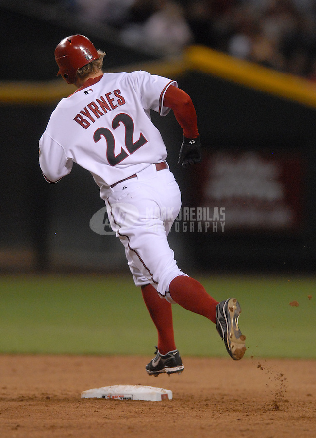 Apr 13, 2007; Phoenix, AZ, USA; Arizona Diamondbacks right fielder (22) Eric Byrnes rounds the bases after hitting a sixth inning two run home run against the Colorado Rockies at Chase Field in Phoenix, AZ. Mandatory Credit: Mark J. Rebilas