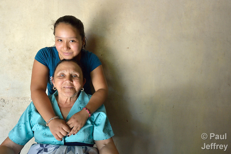 Aleska Garcia, 17, poses with her grandmother, Petronila Reyes, at their home in Goascoran, Honduras. The teenager left Honduras in June 2014 to travel north to be with her mother, who lives in the United States, but she was detained by Mexican law enforcement officials and returned to Honduras. For now she says she wants to remain at home and finish her high school studies.