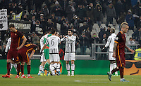 Juventus' players, at center, celebrate as Roma's players react at the end of the Italian Serie A football match between Juventus and Roma at Juventus Stadium. Juventus won 1-0.