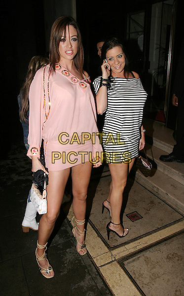 FRANCESCA DIAZ & LINDSEY DAWN MCKENZIE.Brits after party at Kensington Roof Gardens.17 February 2004.Linsey, linzi, full length, full-length, pink minidress, louis vuitton handbag, lace up tie up strappy sandals, black & white stripy stripes.www.capitalpictures.com.sales@capitalpictures.com.© Capital Pictures.