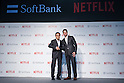 (L to R) Ken Miyauchi, President and CEO of SoftBank Group Corp. and Greg Peters, president of Japan at Netflix Inc. shake hands during a media event to announce a business alliance for the Netflix video delivery service in Japan on August 24, 2015, Tokyo, Japan. From September 2nd SoftBank's 37 million users will be able to access a Netflix Inc. subscription starting at 650 JPN (5.34 USD) for a Standard SD plan. The companies also plan to work on joint content creation projects. (Photo by Rodrigo Reyes Marin/AFLO)