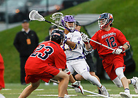 Tehoka Nanticoke (#1) looks for an opening between Richmond defenders Rob Schotta (#23) and Austin Cates (#12) as UAlbany Men's Lacrosse defeats Richmond 18-9 on May 12 at Casey Stadium in the NCAA tournament first round.