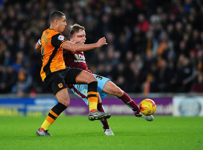 Burnley's Scott Arfield vies for possession with Hull City's Jake Livermore<br /> <br /> Photographer Chris Vaughan/CameraSport<br /> <br /> Football - The Football League Sky Bet Championship - Hull City v Burnley - Saturday 26th December 2015 - Kingston Communications Stadium - Hull<br /> <br /> &copy; CameraSport - 43 Linden Ave. Countesthorpe. Leicester. England. LE8 5PG - Tel: +44 (0) 116 277 4147 - admin@camerasport.com - www.camerasport.com