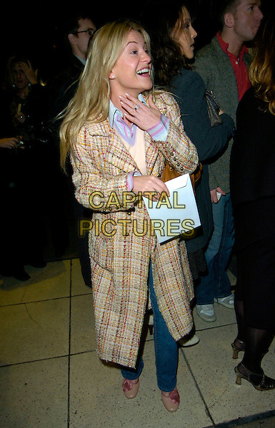 "NICOLA STAPLETON. At the ""Wicked"" Gala Performance & Cast Change,.Appolo Theatre, London, England, 9th January 2007..full length beige cream coat jeans shoes nichola hand funny face .CAP/CAN.©Can Nguyen/Capital Pictures"