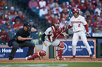 Arkansas Razorbacks catcher Casey Opitz (12) checks the runner on first base after blocking a pitch in the dirt as home plate umpire Michael Banks and Trent Brown (2) of the Oklahoma Sooners look on during game two of the 2020 Shriners Hospitals for Children College Classic at Minute Maid Park on February 28, 2020 in Houston, Texas. The Sooners defeated the Razorbacks 6-3. (Brian Westerholt/Four Seam Images)