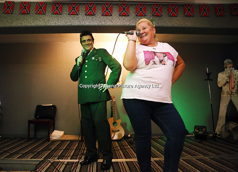Pictured: An Elvis Presley impersonator from the singer's army period, performs a duet with a fan at the Brentwood Hotel, which has been renamed to Heartbreak Hotel for the festival. Friday 22 September 2017<br />Re: Porthcawl Elvis Festival 2017, at the seaside town in Wales, UK