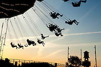 Amusement park riders are silhouetted against the sky at Chicago's Navy Pier on Lake Michigan near downtown Chicago, Ill. Navy Pier is a 50-acre park and promenade in downtown Chicago.