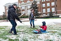 ississippi State University seniors Ronald Crabtree and Manoni Kvekveskiri-Crabtree pull their son, Ronald, through the snow on the Drill Field. The winter weather prompted a campus closure Tuesday [Jan. 16] and Wednesday [Jan. 17], but the university returned to full operations on Thursday [Jan. 18]. <br />  (photo by Megan Bean / &copy; Mississippi State University)