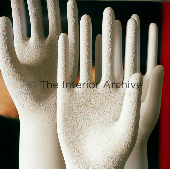 Three sculptures of hands makes a striking trio.