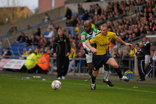 07.11.2009. Oxford United forward James Constable tries to get away from Yeovil defender Tyrell Forbes during the FA Cup first round match at the Kassam Stadium, Oxford. Photographer:Paul Roberts/Actionplus