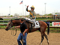 Photo By Michael R. Schmidt.Winning jockey Sheldon Russell gives a thumbs up after winning the 2012 llinois Derby. Done Talking (13) edged out Morgan's Guerrilla (12) for the 55th running of the grade III Illinois Derby Saturday afternoon at Hawthorne Racecourse. Sheldon Russell was aboard Done Talking; Trainer, Hamilton A. Smith; Bred in Kentucky by Skeedattle Associates.