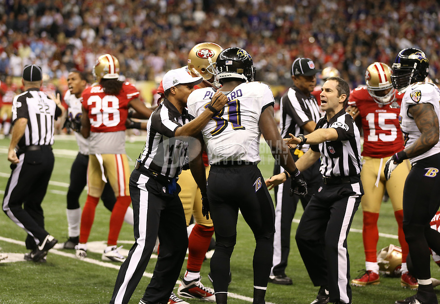 Feb 3, 2013; New Orleans, LA, USA; NFL referee Jerome Boger attempts to hold back Baltimore Ravens safety Bernard Pollard (31) from fighting a San Francisco 49ers player in the first half of Super Bowl XLVII at the Mercedes-Benz Superdome. Mandatory Credit: Mark J. Rebilas-