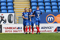 Jack Marriott of Peterborough United (left) celebrates after he scores the opening goal of the game during the Sky Bet League 1 match between Peterborough and Oxford United at the ABAX Stadium, London Road, Peterborough, England on 30 September 2017. Photo by David Horn.