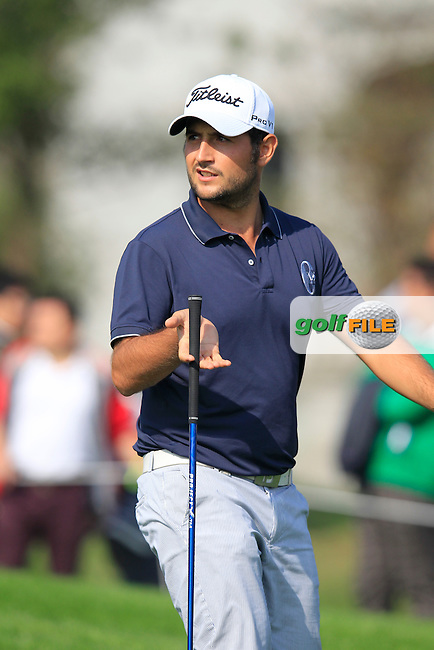 Alexander Levy (FRA) walks off the 10th tee during Sunday's Final Round of the 2014 BMW Masters held at Lake Malaren, Shanghai, China. 2nd November 2014.<br /> Picture: Eoin Clarke www.golffile.ie