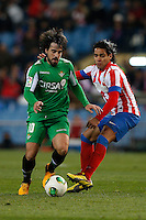 17.01.2013 SPAIN - Copa del Rey Matchday 1/2th  match played between Atletico de Madrid vs Real Betis Balompie (2-0) at Vicente Calderon stadium. The picture show Benat Etxebarria Urkiaga and  Radamel Falcao Garcia (Colombian striker of At. Madrid)