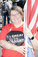 "LaBeccah Davis, of Longview, Texas, wears a shirt reading ""It's Great to be Straight / Genesis 1"" and holds a Straight Pride flag before marching in the Straight Pride Parade in Boston, Massachusetts, on Sat., August 31, 2019."