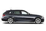 Passenger side profile view of a 2013 BMW 330d Touring Wagon