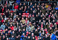 Lincoln City fans watch their team in action<br /> <br /> Photographer Andrew Vaughan/CameraSport<br /> <br /> The EFL Sky Bet League Two - Lincoln City v Forest Green Rovers - Saturday 3rd November 2018 - Sincil Bank - Lincoln<br /> <br /> World Copyright &copy; 2018 CameraSport. All rights reserved. 43 Linden Ave. Countesthorpe. Leicester. England. LE8 5PG - Tel: +44 (0) 116 277 4147 - admin@camerasport.com - www.camerasport.com