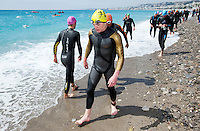 24 APR 2011 - NICE, FRA - David Bishop (Triathlon Olympique Club Cesson Sevigne) warms up before the start of the first round of the men's 2011 French Grand Prix triathlon series .(PHOTO (C) NIGEL FARROW)