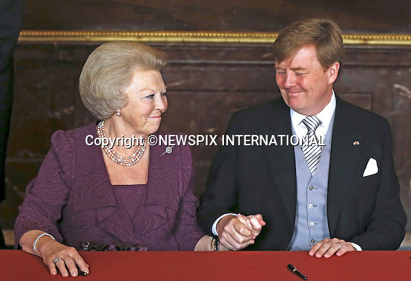 """30.04.2013; Amsterdam : QUEEN BEATRIX OF NETHERLANDS ABDICATES.Queen Beatrix with son King Willem-Alexander after the signing the Act of Abdication in his favour, in the Mozeszaal or Mozes Hall of the Royal Palace, Amsterdam, The Netherlands..Mandatory Credit Photos: ©Maat/NEWSPIX INTERNATIONAL..**ALL FEES PAYABLE TO: """"NEWSPIX INTERNATIONAL""""**..PHOTO CREDIT MANDATORY!!: NEWSPIX INTERNATIONAL(Failure to credit will incur a surcharge of 100% of reproduction fees)..IMMEDIATE CONFIRMATION OF USAGE REQUIRED:.Newspix International, 31 Chinnery Hill, Bishop's Stortford, ENGLAND CM23 3PS.Tel:+441279 324672  ; Fax: +441279656877.Mobile:  0777568 1153.e-mail: info@newspixinternational.co.uk"""