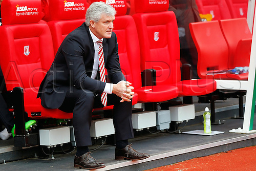 27.02.2016. Britannia Stadium, Stoke, England. Barclays Premier League. Stoke City versus Aston Villa. Stoke City Manager Mark Hughes watches from the dugout