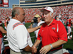 MADISON, WI - SEPTEMBER 11: Head coach Barry Alvarez of the University of Wisconsin Badgers shakes hands with head coach John Robinson of the University of Nevada-Las Vegas after the game on September 11, 2004 at Camp Randall Stadium in Madison, Wisconsin. The Badgers beat the Rebels 18-3. (Photo by David Stluka)
