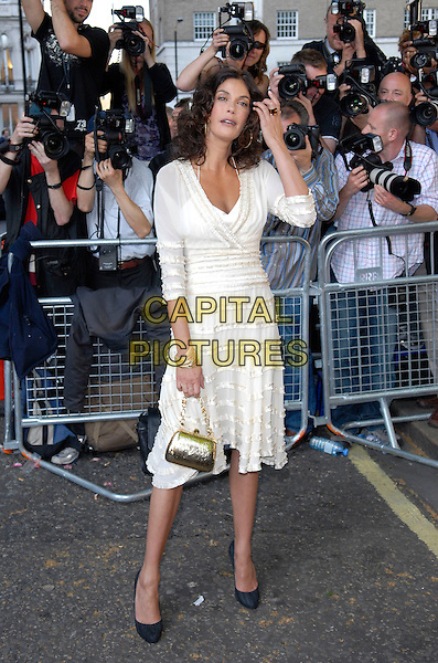 TERI HATCHER.Arrivals at the 4th Annual Glamour Women Of The Year Awards, Berkely Square Gardens, London, England. .June 5th 2007.full length white cream dress sheer black shoes hand purse bag gold  Christian Louboutin .CAP/FIN.©Steve Finn/Capital Pictures