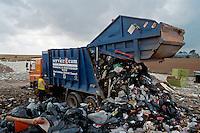Dustcart emptying its load at the landfill site..©shoutpictures.com..john@shoutpictures.com
