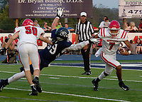 Fort Smith Northside quarterback Dreyden Norwood escapes Greenwood defender Jordan Hanna in the first quarter of Friday's game in Greenwood. Blocking on the play is Jacob Arnold.