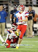 Manatee Hurricanes kicker Nick Tankersley #14 and holder Ja Juan Pollock #3 watch the kick during the second quarter of the Florida High School Athletic Association 7A Championship Game at Florida's Citrus Bowl on December 16, 2011 in Orlando, Florida.  The score at halftime is Manatee 17 - First Coast 0.  (Photo By Mike Janes Photography)