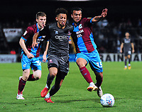 Lincoln City's Kellan Gordon vies for possession with Scunthorpe United's Clayton Lewis<br /> <br /> Photographer Andrew Vaughan/CameraSport<br /> <br /> The EFL Checkatrade Trophy Northern Group H - Scunthorpe United v Lincoln City - Tuesday 9th October 2018 - Glanford Park - Scunthorpe<br />  <br /> World Copyright &copy; 2018 CameraSport. All rights reserved. 43 Linden Ave. Countesthorpe. Leicester. England. LE8 5PG - Tel: +44 (0) 116 277 4147 - admin@camerasport.com - www.camerasport.com