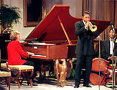 "Jazz legends Marian McPartland (on Piano) and Wynton Marsalis (Trumpet) perform during the live broadcast of the ""Millennium Evening Lecture Series"" from The White House in Washington, D.C. on September 18, 1998..Credit: Ron Sachs / CNP"