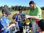 Green Bay Packers linebacker A.J. Hawk signs autographs during a practice round at the 22nd American Century Celebrity Golf Championship at Edgewood Tahoe Golf Course in Stateline, Nev., on Thursday, July 14, 2011. (AP Photo/Cathleen Allison)
