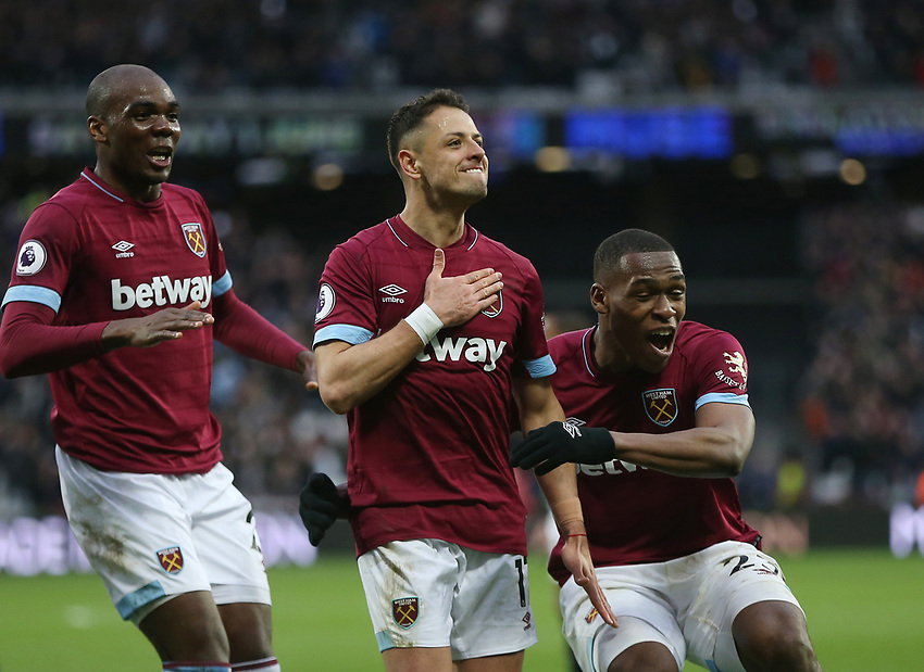 West Ham United's Javier Hernandez celebrates scoring his side's fourth goal with Issa Diop and Angelo Ogbonna<br /> <br /> Photographer Rob Newell/CameraSport<br /> <br /> The Premier League - West Ham United v Huddersfield Town - Saturday 16th March 2019 - London Stadium - London<br /> <br /> World Copyright © 2019 CameraSport. All rights reserved. 43 Linden Ave. Countesthorpe. Leicester. England. LE8 5PG - Tel: +44 (0) 116 277 4147 - admin@camerasport.com - www.camerasport.com