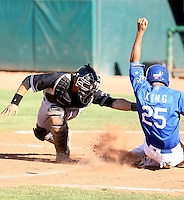 Jae Yun Kim - 2010 Missoula Osprey - Pioneer League, playing against the Ogden Raptors at Lindquist Field, Ogden, UT - 07/25/2010. Kim tags out Austin King trying to score..Photo by:  Bill Mitchell/Four Seam Images..