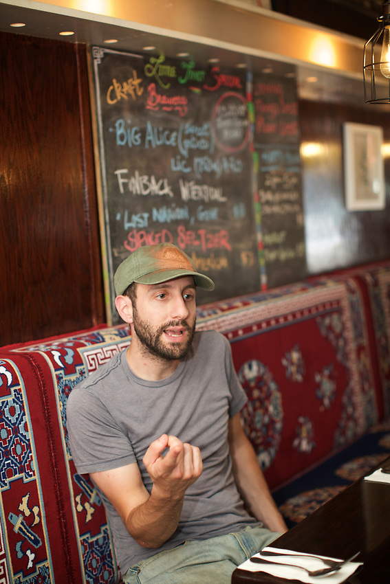 Queens, NY - July 10, 2017: Jeff Orlick at Little Tibet, the 2016 winner of the Momo Crawl in Jackson Heights.<br />