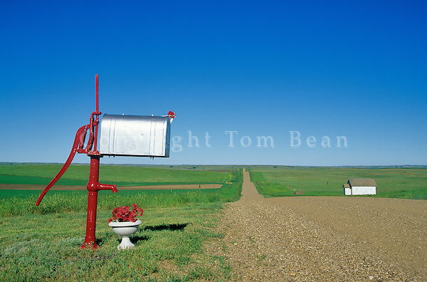 Ranch mailbox and along country road with old country school house on Great Plains near Bison, South Dakota, AGPix_0261.
