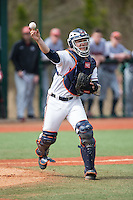 Virginia Cavaliers catcher Matt Thaiss (21) makes a throw to first base against the Hartford Hawks at The Ripken Experience on February 27, 2015 in Myrtle Beach, South Carolina.  The Cavaliers defeated the Hawks 5-1.  (Brian Westerholt/Four Seam Images)