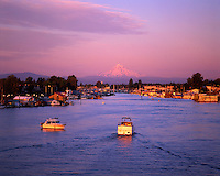 USA, Oregon, evening light on pleasure boats and house boats located on the Columbia River Channel at Hayden Island with Mt. Hood in the distance.