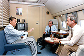 United States President Ronald Reagan, left, meets with White House Chief of Staff Donald Regan and National Security Advisor Robert McFarlane aboard Air Force One on Sunday, July 21, 1985..Mandatory Credit: Bill Fitz-Patrick - White House via CNP