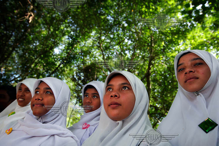 School children are brought on a day out to the Conservation Response Unit (CRU) on the edge of the Ulu Masen Forest to learn about why the forest is important for the local community. Fauna and Flora International (FFI) and The Aceh Forest and Environment Project (funded by the World Bank and the Multi Donor Fund) have set up the Conservation Response Unit on the edge of the Forest. The CRU is responsible for training rangers and working to help community members understand how to best protect the forest whilst providing economic benefits and and livelihood opportunities to local communities.